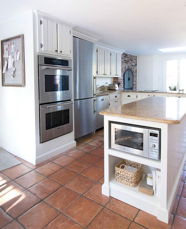 kitchen-saltillo-floors-white-cabinets-fireplace.jpg